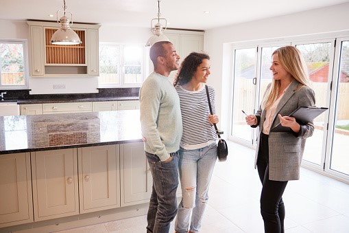 https://media.istockphoto.com/photos/female-realtor-showing-couple-interested-in-buying-around-house-picture-id1166187828?b=1&k=6&m=1166187828&s=170667a&w=0&h=0yx1Id0cHZMispSl6l0J421oG5GZAxN5hOQp-zM4nJM=